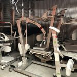 Patient lifting equipment in storage